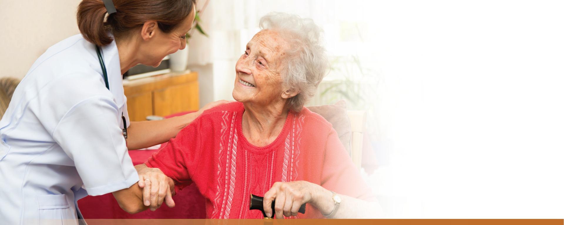 Nurse helping a senior woman stand up