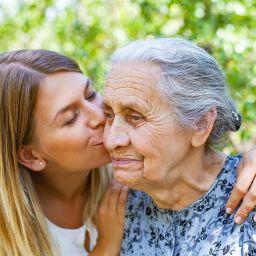 daughter kisses mom