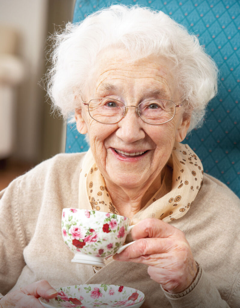 Happy Senior woman with a warm cup of tea